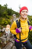 Woman hiking in mountains with akita dog Karkonosze Mountain Range poster
