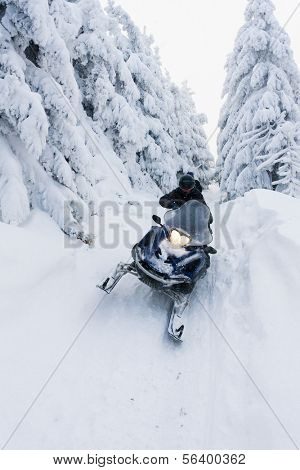 man riding on snow scooter, Orlicke Mountains, Czech Republic