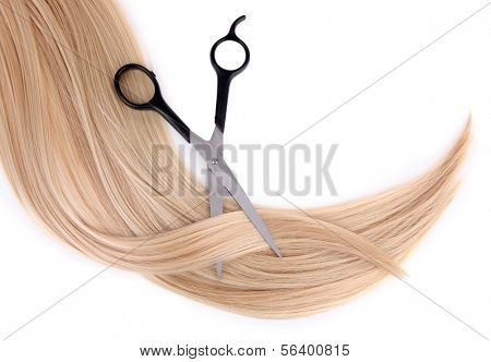 Long blond hair and scissors isolated on white
