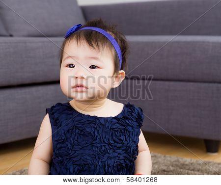 Asian baby girl at home