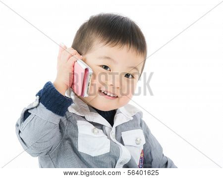 Cute boy talk to phone