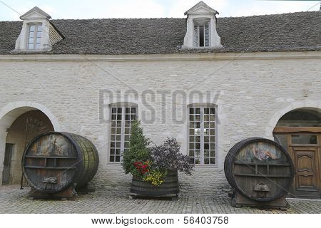 An old painted wine barrels in Chateau de Pommard, Burgundy, France