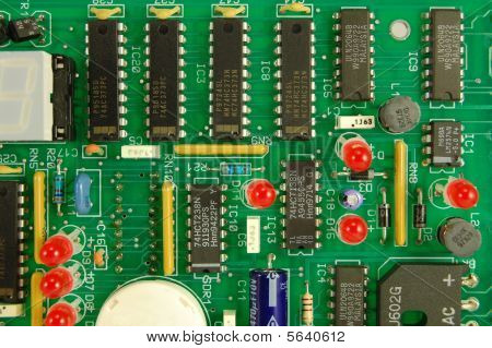 A colorful printed wiring board assembly showing integrated circuits (ICs) and LED lamp components poster