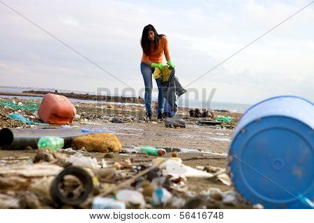 Strong Young Woman Cleaning And Volunteering