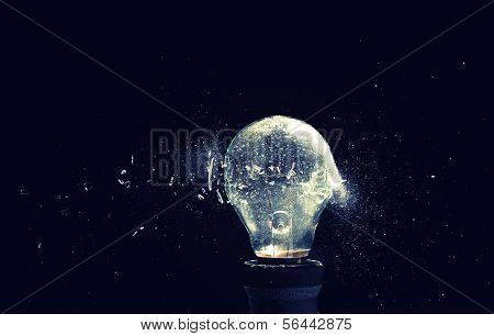 close up image of electric bulb explosion poster