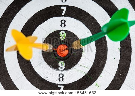 Bullseye. Black And White Target With Darts As Sport Background