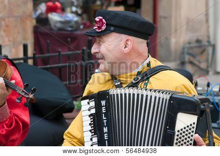 Jerusalem, Israel - 15 March 2006: Purim Carnival Street Musician Plays The Accordion.