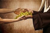 Jesus gives bread and grapes on beige background poster