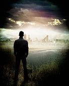 Rear view of man watching lake and cityscape on the shore poster