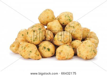 a pile of bunuelos de bacalao, spanish cod fritters, on a white background