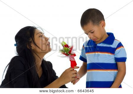 Small Boy Apologising To His Mother