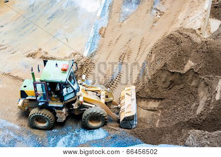 Wheel Loader Excavator Unloading Sand On Construction Site