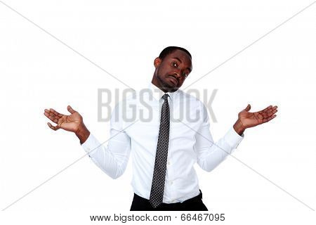 Portrait of a african man with a kind of uncomprehending opened his arms to the sides