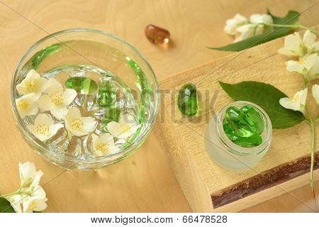 Bowl with water and jasmine flowers, SPA concept