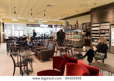MOSCOW - MARCH 30: Starbucks cafe in Sheremetyevo airport on March 30, 2014 in Moscow. Starbucks Corporation is an American global coffee company and coffeehouse chain based in Seattle, Washington