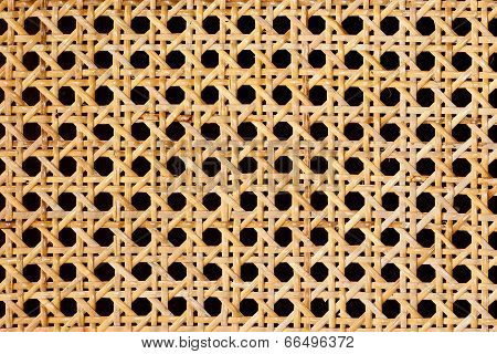 Closeup of rattan weave isolated on black background poster