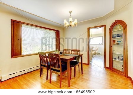 Soft Tones Dining Room With Wooden Furniture
