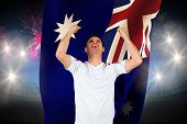 Cheering football fan in white against fireworks exploding over football stadium and australia flag poster