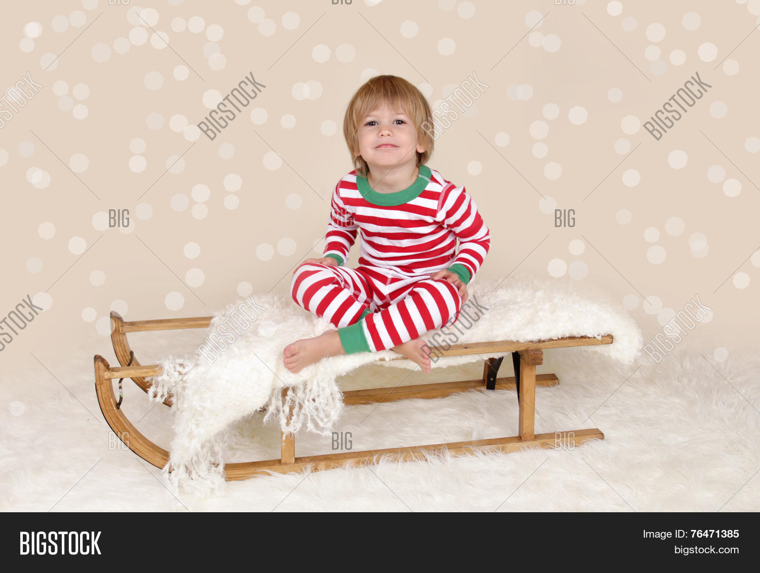 df4d638e67 Winter Holidays  Laughing Happy Child In Christmas Pajamas Sled In Snow