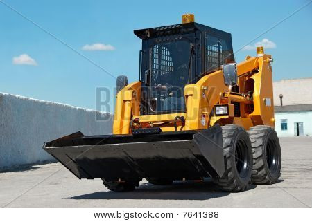 skid steer loader construction machine with bucket outdoors poster