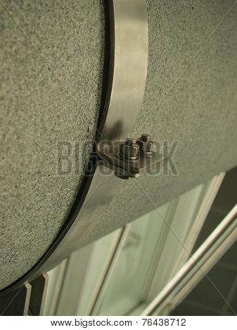 Metalic bolt holding a steel belt