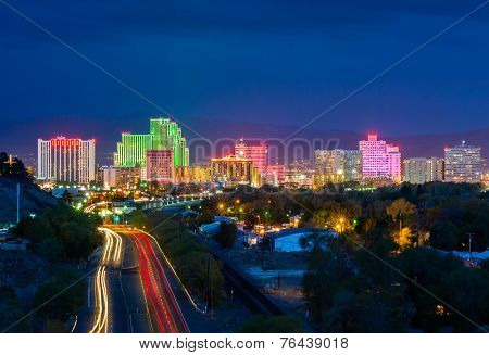 RENO - OCTOBER 31: Reno skyline on October 31, 2014. It's known as The Biggest Little City in the World, famous for its casinos and is the birthplace of the gaming corporation Harrah's Entertainment.
