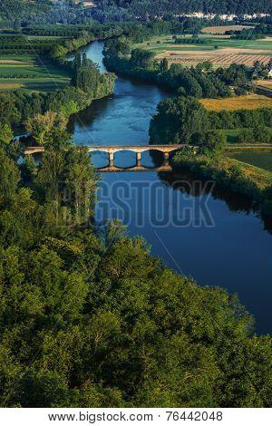 medieval bridge over the Dordogne river Perigord france