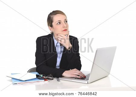 Attractive Businesswoman Thinking And Looking Distraught While Working On Computer