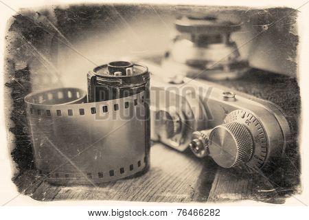 Old Photo Film Roll And Retro Camera