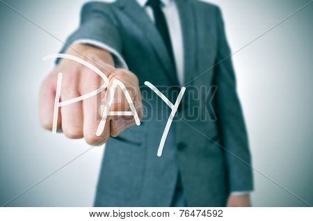 man in suit pointing the finger to the word pay written in the foreground