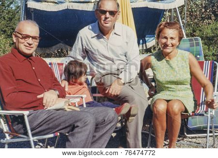STOCKHOLM, SWEDEN, SEPTEMBER 7, 1969: Vintage photo of family with little girl outdoor