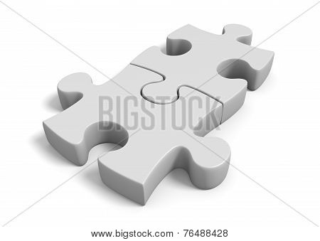 Two jigsaw puzzle pieces locked together in a connected position