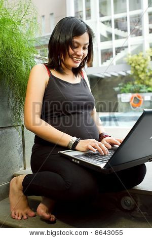 Asian Pregnant Woman Happy Working With Laptop