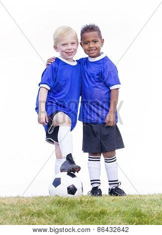 Two diverse young soccer players on white background. Full length view of two youth recreation league soccer players.