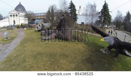 MOSCOW, RUSSIA - MAR 23, 2014: Big sculptures of animals in park of VVC exhibition center at sunny day. Aerial view