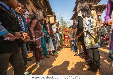 BHAKTAPUR, NEPAL - CIRCA DEC, 2013: Unidentified children during Birthday celebration head of family - 77 years 7 months 7 days 7 hours old, like rebirth according to Newar.