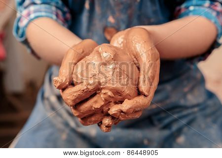 Piece of clay in hands