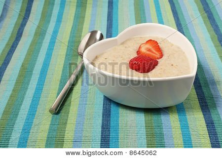 Porridge In A Heart Shaped Bowl With Strawberries