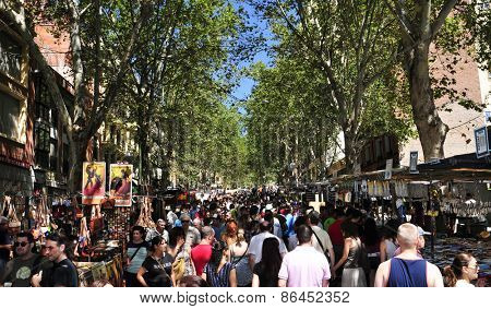 MADRID, SPAIN - AUGUST 10: Overlook of El Rastro flea market on August 10, 2014 in Madrid, Spain. This popular open air flea market is held every Sunday and public holiday