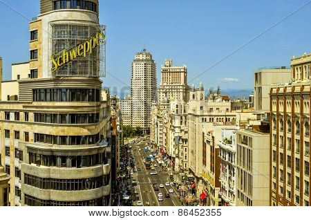 MADRID, SPAIN - AUGUST 11: Aerial view of the Gran Via street on August 11, 2014 in Madrid, Spain, the Spanish Broadway, with the iconic neon advertisement for Schweppes in the foreground