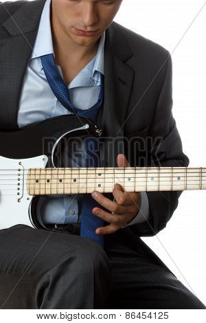 Man In Suit And Tie Playing Electric Guitar