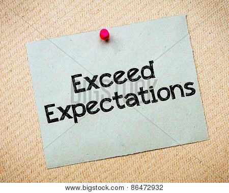 Exceed Expectations Message. Recycled paper note pinned on cork board. Concept Image poster