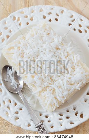 Sweet Couscous (tapioca) Pudding (cuscuz Doce) With Coconut On White Plate