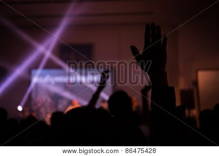 christian music concert with raised hand, live