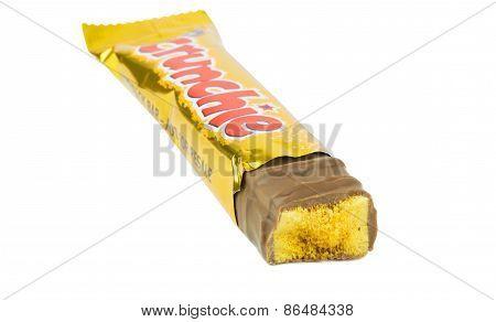 A single Cadbury crunchie chocolate bar