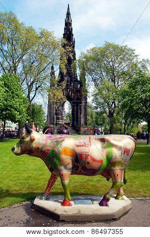 Cow parade sculpture at the Scott monument, Edinburgh