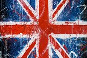 Painted concrete wall with graffiti of British flag. Grunge flag of United Kingdom. Union Jack poster