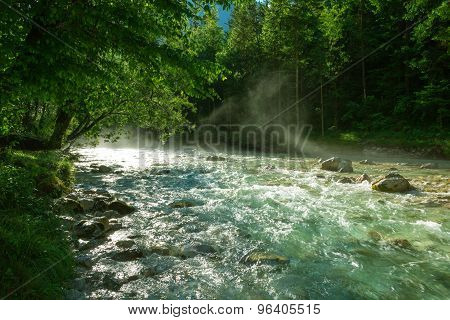Mist over Soca river on an early summer morning poster
