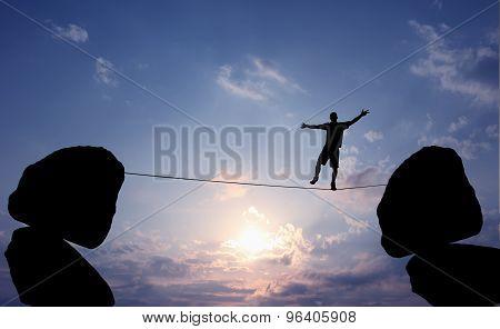 Man Balancing On The Rope