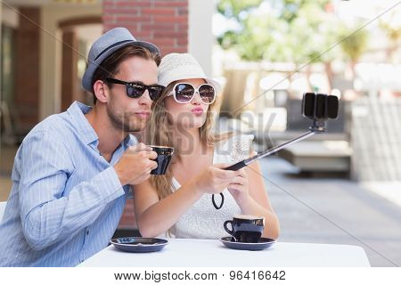 Cute couple taking a selfie while doing funny faces